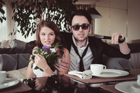 intended: New married couple in a cafe Stock Photo