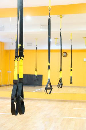 contortion: aerial ribbons in a modern fitness hall  Stock Photo