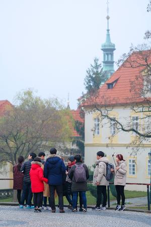 excursion: Prague, Czechia - November, 21, 2016: tourists on an excursion in Prague, Czechia