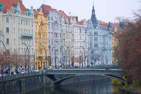 Prague, Czechia - November, 24, 2016: panorama of an old Prague, bridges and embankment of Vitava river, Czechia