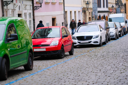 family units: Prague, Czechia - November, 23, 2016: cars parking on a street in an Old Town of Prague, Czechia