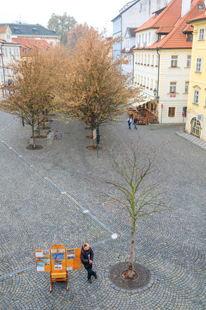 family unit: Prague, Czechia - November, 21, 2016: garden in the historical part of Prague, Czechia