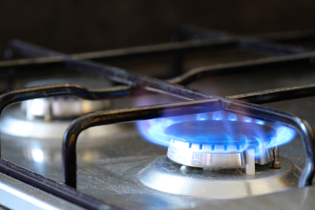 old gas stove: Fire on a kitchen gas stove Stock Photo