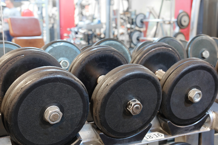 The image of dumbbells in a fitness hall