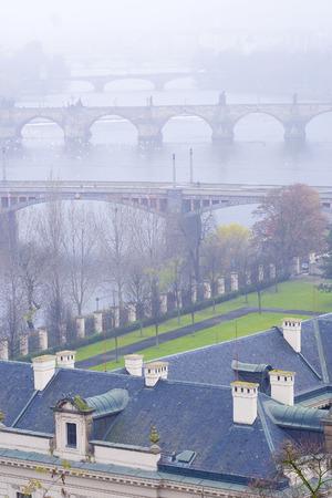 Prague, Czechia - November, 24, 2016: panorama of an old Prague, bridges and embankment of Vitava river, Czechia