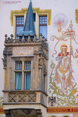 front elevation: Prague, Czechia - November, 21, 2016: front of a building with mural on Old Town Square in Prague, Czechia