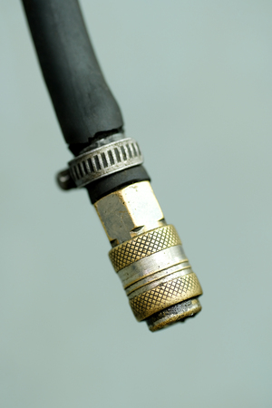 lug: Close up rubber hose with a metallic connector lug Stock Photo
