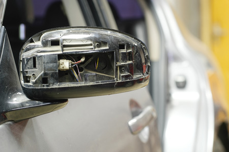 Crashed mirror of a car Stock Photo