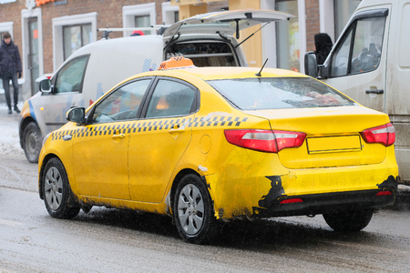 Moscow, Russia, December, 8, 2016: Close up image of Moscow yellow taxi Editorial