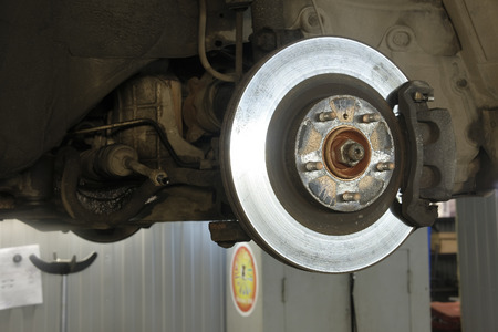 sliding caliper: caliper of the car which is hung out on the lift Stock Photo