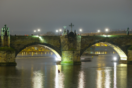 Prague, Czechia - November, 21, 2016: Panorama of an old Prague, bridge and embankment of Vitava river, Czechia