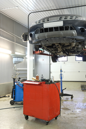 sliding caliper: car on a lift in a car repair station