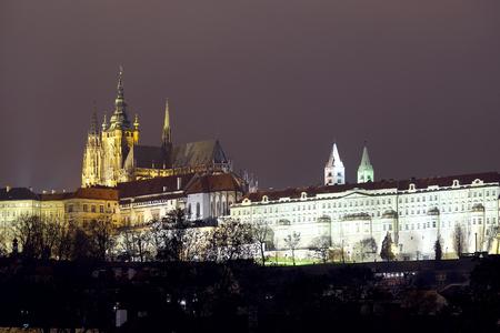 Prague, Czechia - November, 21, 2016: Panorama of an old Prague, bridges and embankment of Vitava river, Czechia in a night Stock Photo