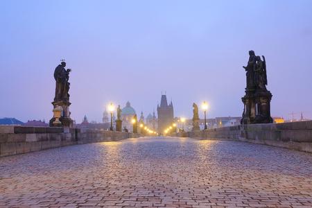 Prague, Czechia - November, 21, 2016: Charles Bridge in Prague, Czechia early in the morning Stock Photo