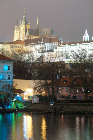 Prague, Czechia - November, 21, 2016: Panorama of an old Prague, bridges and embankment of Vitava river, Czechia in a night Editorial