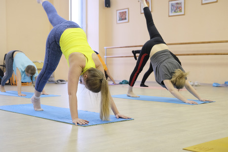Moscow, Russia - February, 14, 2017: female group on yoga training in Moscow fitness center Editorial