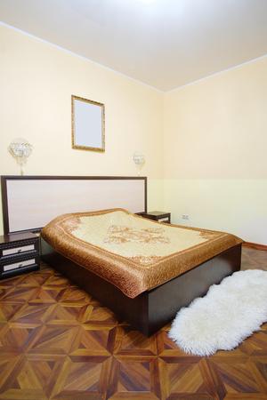 counterpane: Interior of a hotel bedroom Stock Photo