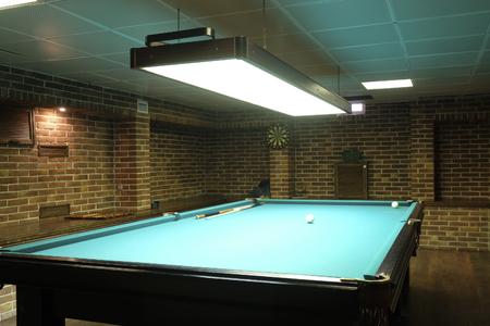 snooker hall: Interior of a billiard hall