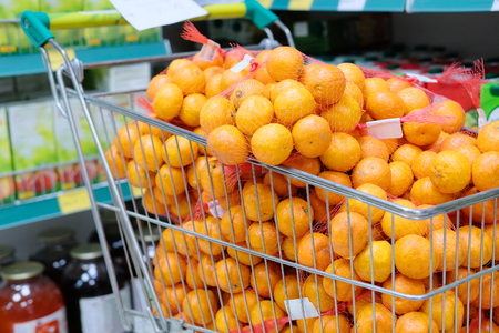 Mandarins in a trolley in a shop Stock Photo