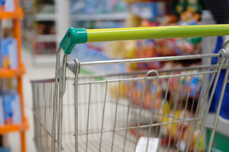 Shop trolley in a supermarket close up Stock Photo