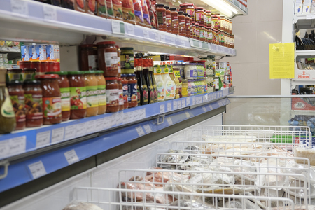 icebox: Kaluga, Russia - April, 21, 2017: Interior of a supermarket in Kaluga, Russia with refregerator on a frontground