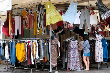 Ferrara, Italy - June, 30, 2017: clothes saled in a street market in Ferara, Italy