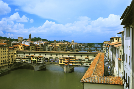 parapet: Florence, Italy - June, 5, 2017: embankment of Arno river in Florence, Italy with Ponte Vecchio bridge over the river