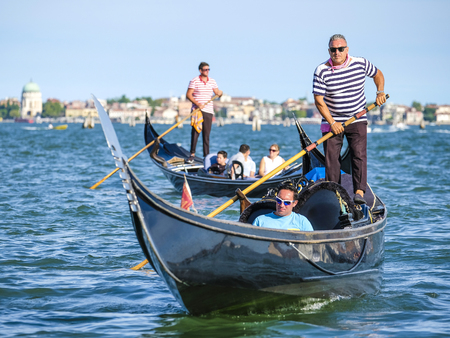 Venice, Italy, May, 31, 2017: gondolas on a channel in Venice, Italy Editorial