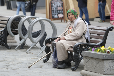 Moscow, Russia - May, 8, 2017: An elderly woman veteran of the 2 World War begs in Moscow on the eve of the magnificently celebrated Victory Day in this war