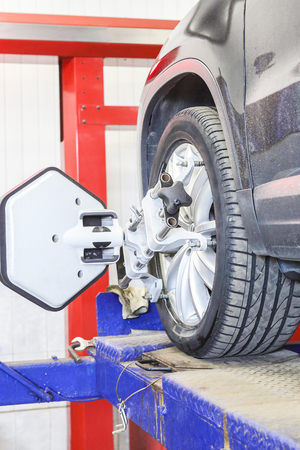 Target of the car wheel angle adjustment equipment fixed on a car wheel Stock Photo