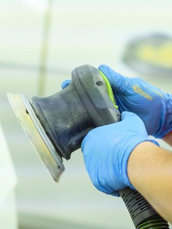 Worker in a car repair station