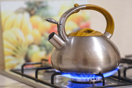 Kettle on a stove 스톡 콘텐츠