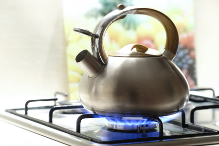 Kettle on a stove 免版税图像