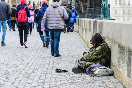 Prague, Czechia - November, 20, 2017: beggar on a street in an Old town of Prague, Czechia