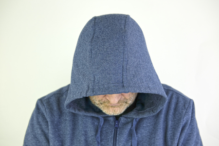 Man in a jacket with hood Stock Photo - 92228358