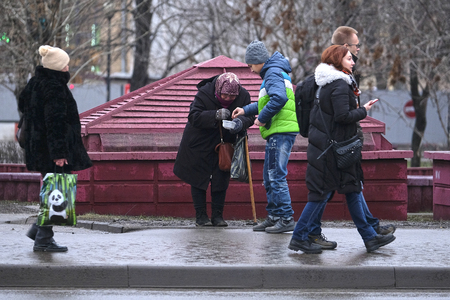 Moscow, Russia - December, 17, 2017: begger stands on Moscow street Editorial