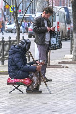 Tula, Russia - April, 28, 2018: woman - begger sits on Tula street Editorial