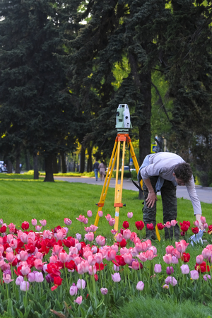 Moscow, Russia - May, 13, 2018: the image of a man with  theodolite