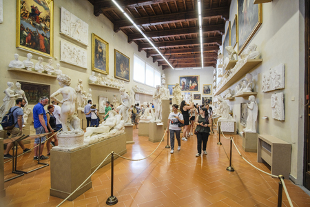 Florence, Italy - June, 3, 2018: Visitors in a museum of Florence Academy of fine arts (Accademia di belle arti di Firenze) Editorial