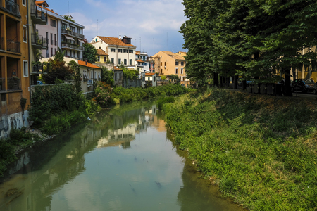 Houses on a bank of channel in Padova' Italy Imagens