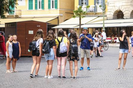 Verona, Italy - July, 15, 2018: tourists on a street in a center of Verona, Italy Stok Fotoğraf