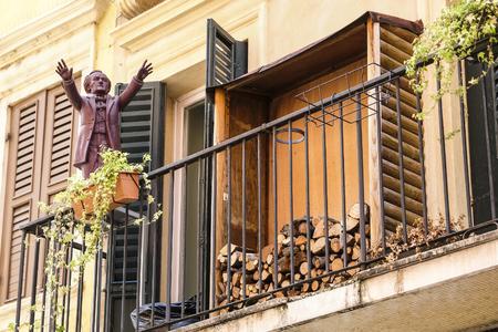 Verona, Italy - July, 15, 2018: balcony of an old house in a center of Verona