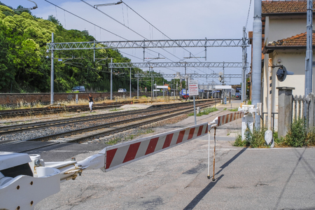 Moncelice, Italy - June, 14, 2018: closed barrier at the railway crossing