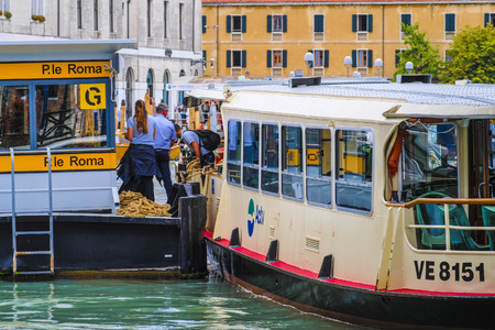 Venice, Italy - June, 28: Regular-route swimming bus on a channel in Venice, Italy Redakční