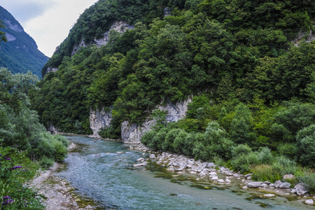 Alpine landscape with the image of Piave river