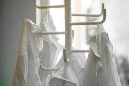 White lab dressings gown on a hanger in a class in Mosocw private school