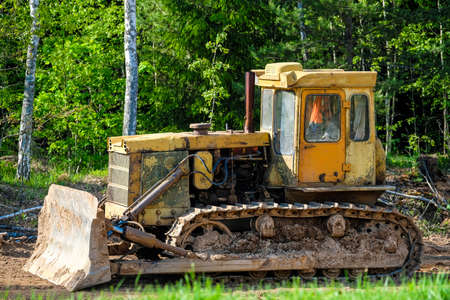 The image of a yellow buldozer