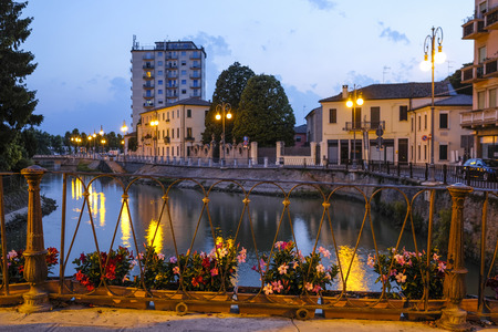 Adria, Italy - July, 07, 2019: cityscape with the image of channel in Adria, Italy in the evening Editorial