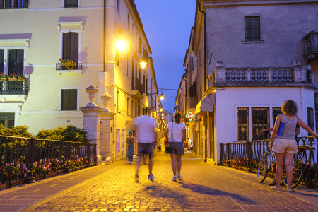 Adria, Italy - July, 11, 2019: one of the central streets of Adria, Italy, in the evening