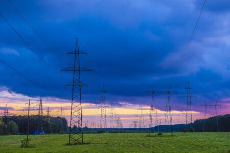 The image of  power lines at sunset